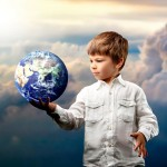 a boy with a globe